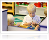 Child Playing with Lego in Pre-Kindergarten